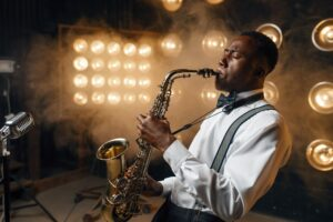 Black jazz performer plays the saxophone on stage